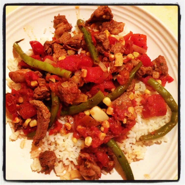 Grilled Lamb, Tomatoes, White Corn, White Onion, String Beans and Fresh Garlic Over Coconut Rice